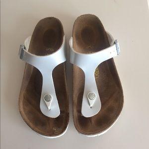 Birkenstock white t-strap sandals.